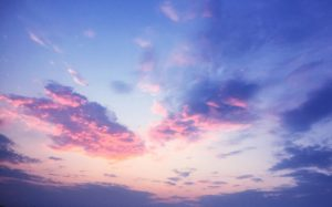 Beautiful Pink Violet Sunset Sky with heart shaped clouds